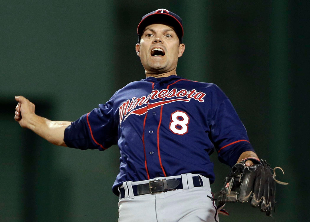 . Minnesota Twins shortstop Jamey Carroll celebrates after turning a double play against the Boston Red Sox during the ninth inning of a baseball game at Fenway Park in Boston, Tuesday, May 7, 2013. The Twins won 6-1. (AP Photo/Elise Amendola)