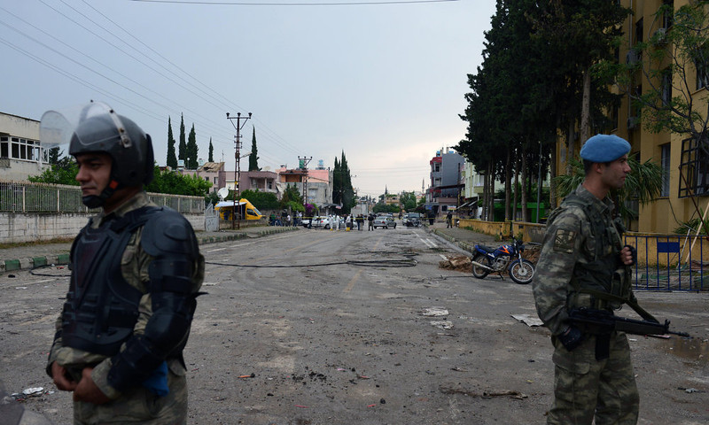 . Turkish army commandos secure the area at the scene of one of the Saturday explosions that killed 46 and injured about 50 others, in Reyhanli, near Turkey\'s border with Syria, Sunday, May 12, 2013.  The twin car bombings on Saturday marked the biggest incident of cross-border violence since the start of Syria\'s bloody civil war and has the raised fear of Turkey being pulled deeper into the conflict.(AP Photo)