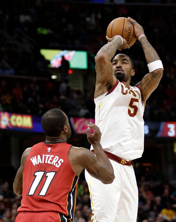 . Cleveland Cavaliers\' JR Smith (5) shoots over Miami Heat\'s Dion Waiters (11) in the first half of an NBA basketball game, Tuesday, Nov. 28, 2017, in Cleveland. (AP Photo/Tony Dejak)