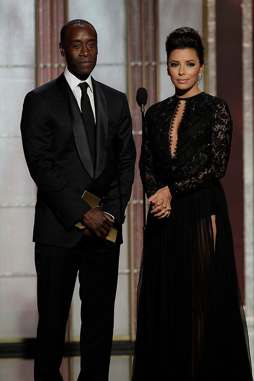. Presenters Don Cheadle (L) and Eva Longoria on stage at the 70th annual Golden Globe Awards in Beverly Hills, California January 13, 2013, in this picture provided by NBC. REUTERS/Paul Drinkwater/NBC/Handout