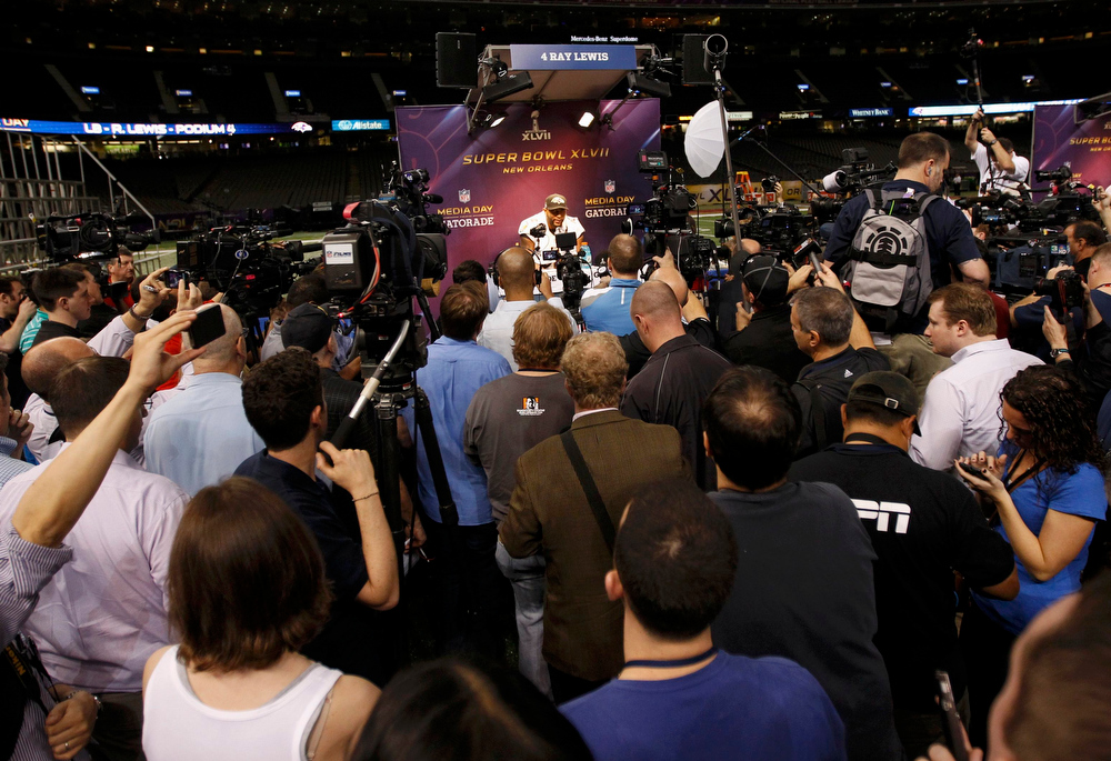 Description of . Baltimore Ravens inside linebacker Ray Lewis is surrounded by journalists during Media Day for the NFL's Super Bowl XLVII in New Orleans, Louisiana January 29, 2013. The San Francisco 49ers will meet the Ravens in the game on February 3. REUTERS/Jeff Haynes
