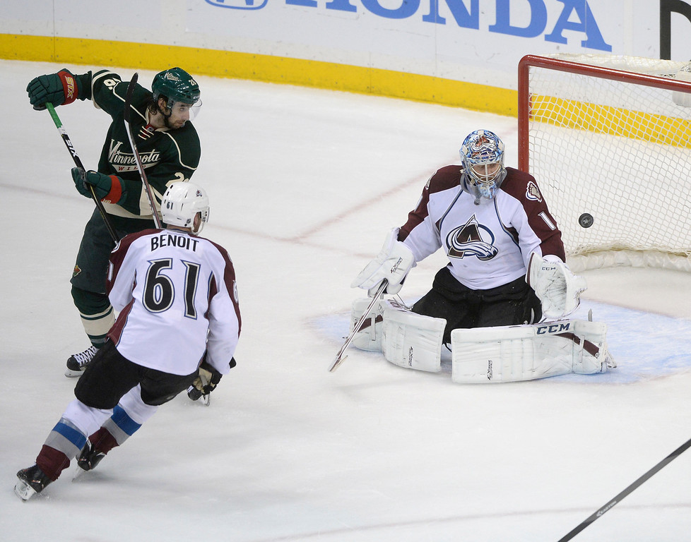 . Minnesota wing Matt Moulson (26) flipped a shot past Colorado goalie Semyon Varlamov in the second period. Varlamov deflected the puck away from the net. The Minnesota Wild hosted the Colorado Avalanche at the Xcel Energy Center in St. Paul Monday night, April 21, 2014. (Photo by Karl Gehring/The Denver Post)