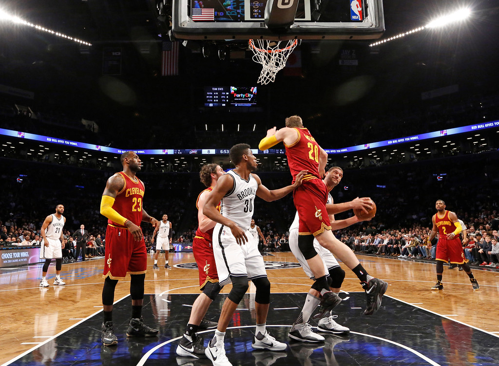 . Brooklyn Nets center Brook Lopez (11) looks for a shot with Cleveland Cavaliers center Timofey Mozgov (20) defending  in the second half of an NBA basketball game, Wednesday, Jan. 20, 2016, in New York. The Cavaliers defeated the Nets 91-78. (AP Photo/Kathy Willens)