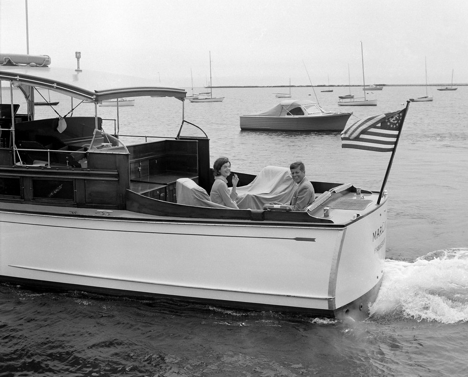 . Sen. Kennedy and wife Jacqueline cruise aboard the  Marlin for a sail around Nantucket Sound on July 19, 1960.  The Kennedys were on vacation in Hyannisport.  Harvey Georges, Associated Press file
