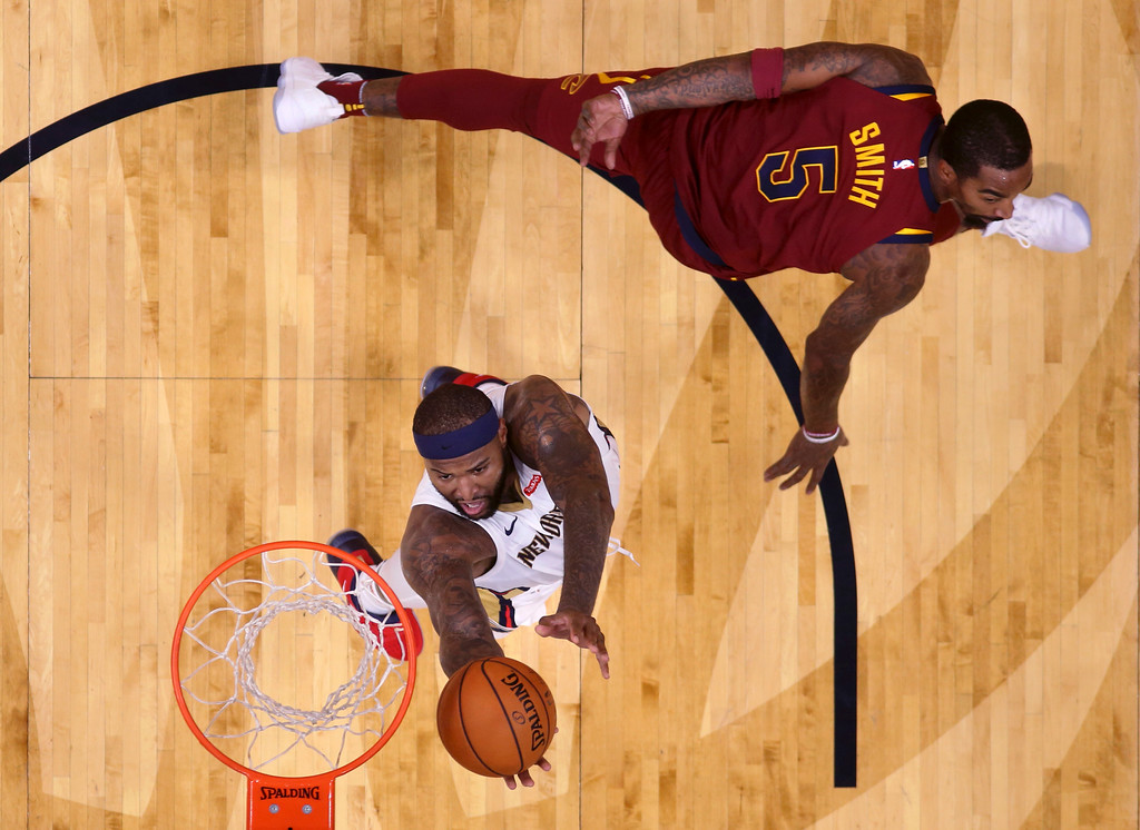 . New Orleans Pelicans forward DeMarcus Cousins goes to the basket against Cleveland Cavaliers guard JR Smith (5) in the first half of an NBA basketball game in New Orleans, Saturday, Oct. 28, 2017. (AP Photo/Gerald Herbert)