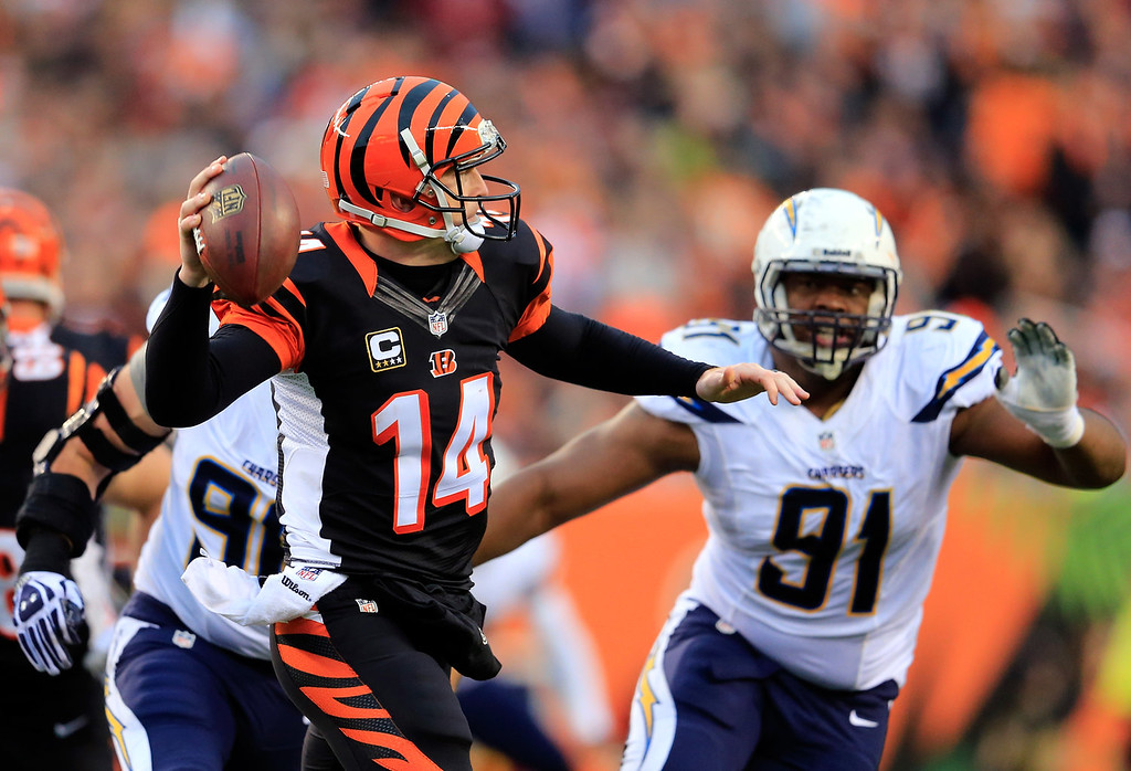 . Quarterback Andy Dalton #14 of the Cincinnati Bengals passes against the San Diego Chargers during a Wild Card Playoff game at Paul Brown Stadium on January 5, 2014 in Cincinnati, Ohio.  (Photo by Rob Carr/Getty Images)