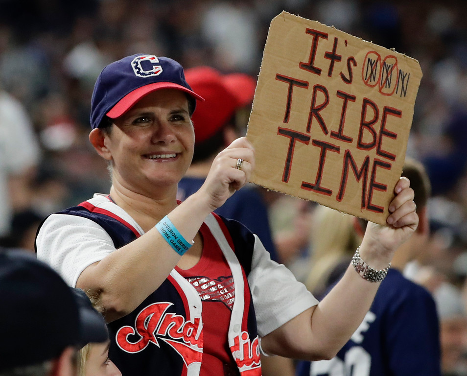 . A Cleveland Indians fan hold up a sign during the fourth inning in Game 3 of baseball\'s American League Division Series against the New York Yankees, Sunday, Oct. 8, 2017, in New York. (AP Photo/Frank Franklin II)