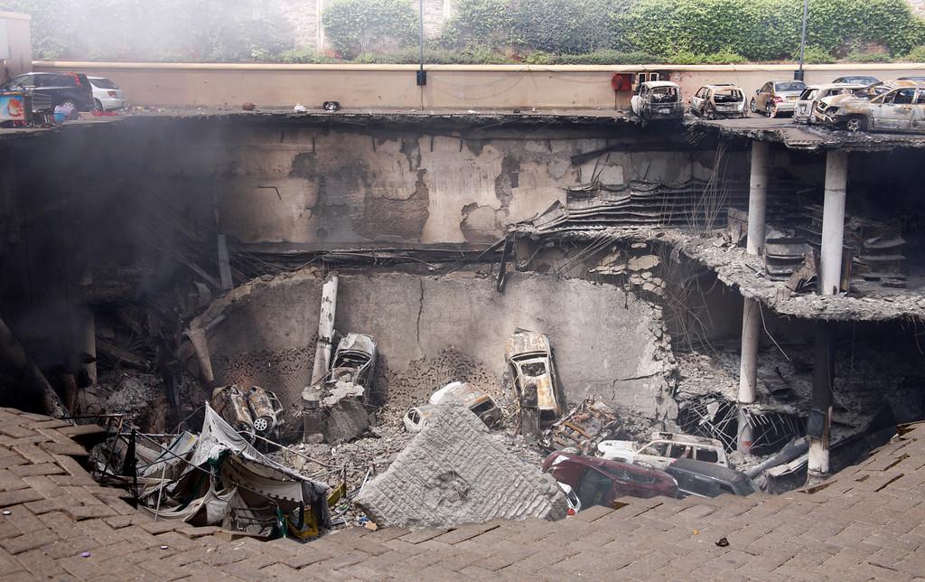 . This photo released by the Kenya Presidency shows the collapsed upper car park of the Westgate Mall in Nairobi, Kenya Thursday, Sept. 26, 2013.  (AP Photo/Kenya Presidency)