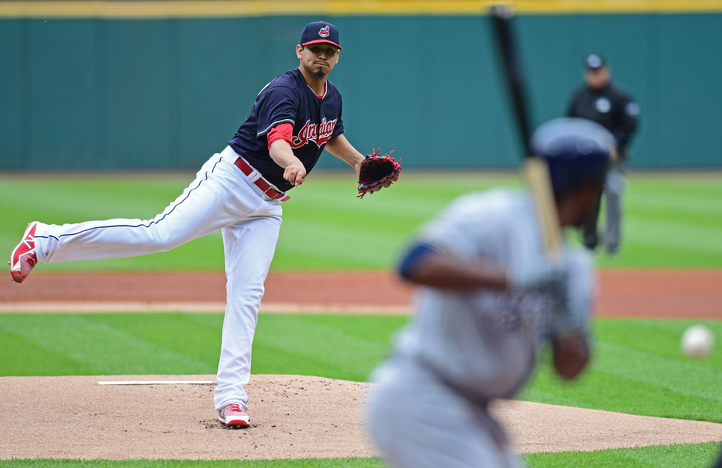 . Cleveland Indians starting pitcher Carlos Carrasco delivers to Milwaukee Brewers\' Jonathan Cain in the first inning of a baseball game, Wednesday, June 6, 2018, in Cleveland. (AP Photo/David Dermer)