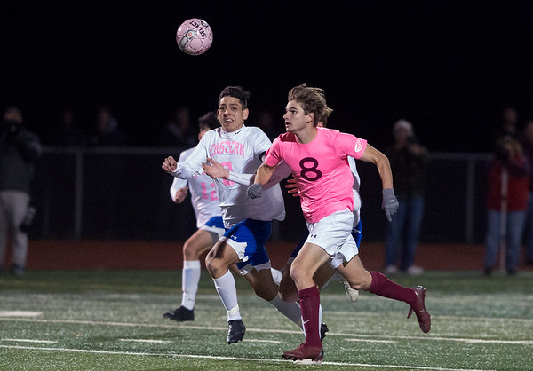 11/04/19 Wesley Bunnell | StaffrrBristol Eastern vs Bristol Central boys soccer on Monday night at Bristol Eastern High School. Bristol Eastern's Dante Costantiello (8) and Central's David Bowes (8).