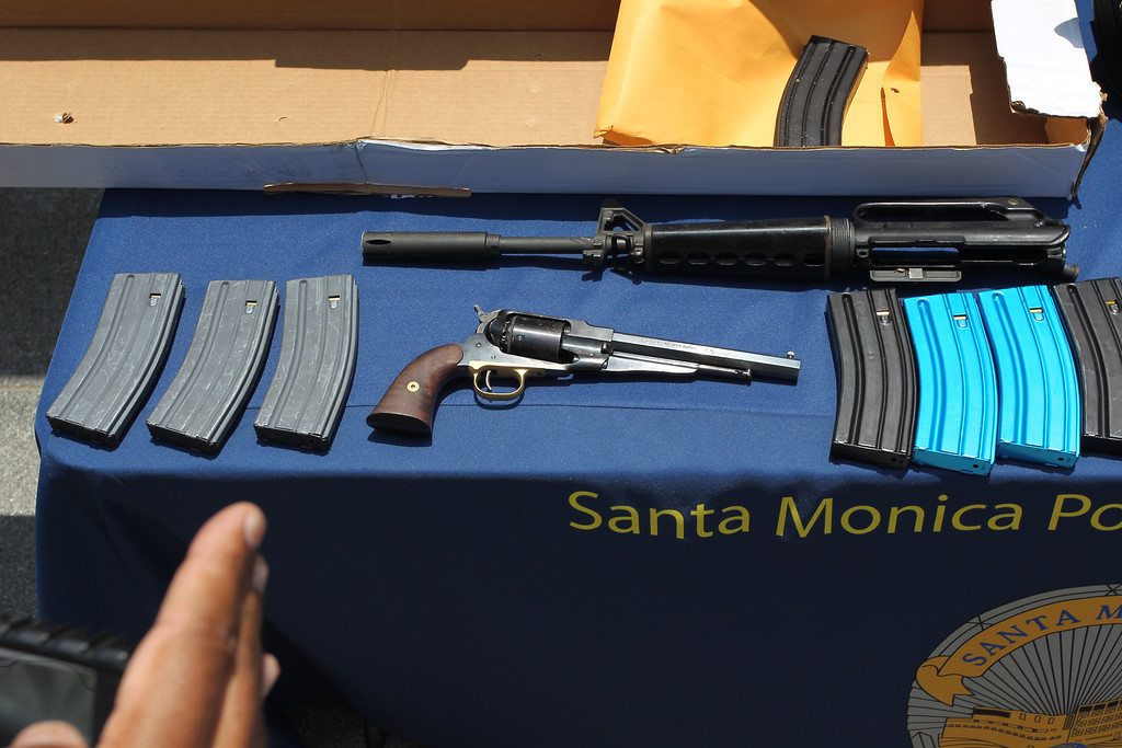 . SANTA MONICA, CA - JUNE 08:  A pistol, part of an AR-15 assault rifle type of gun and ammunition allegedly dropped by a gunman during a mass shooting spree are displayed at the Santa Monica Police Department headquarters on June 8, 2013 in Santa Monica, California.   (Photo by David McNew/Getty Images)