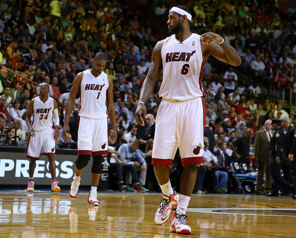 . MIAMI, FL - MARCH 14:  LeBron James #6, Chris Bosh #1, and Ray Allen #34 of the Miami Heat of the Miami Heat look on during a game against the Denver Nuggets at American Airlines Arena on March 14, 2014 in Miami, Florida. (Photo by Mike Ehrmann/Getty Images)