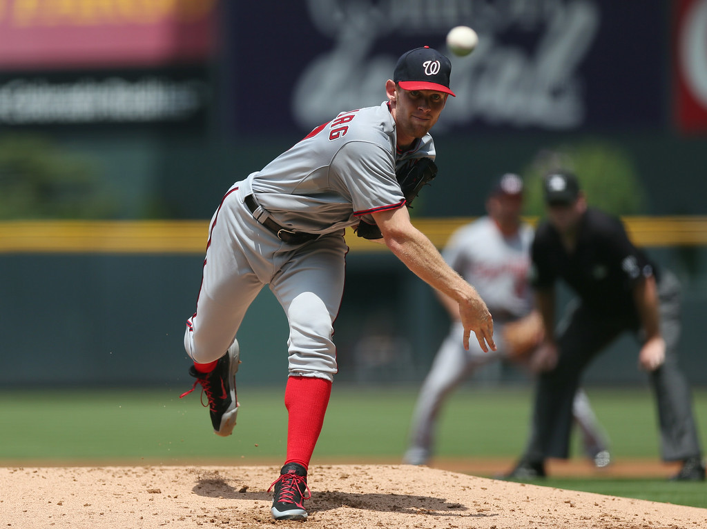 . Washington Nationals starting pitcher Stephen Strasburg works against the Colorado Rockies in the first inning of a baseball game in Denver on Wednesday, July 23, 2014. (AP Photo)