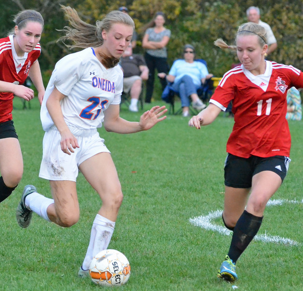 KYLE MENNIG - ONEIDA DAILY DISPATCH Oneida's Sarah Paul (21) dribbles the ball as Vernon-Verona-Sherrill's Marriah Doig (11) defends during their Section III Class B playoff match in Oneida on Tuesday, Oct. 18, 2016.