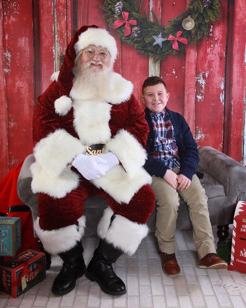 Aerolin and Keegan Meet Santa