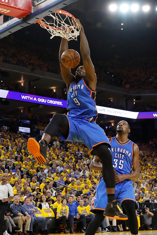 . OAKLAND, CA - MAY 16:  Serge Ibaka #9 of the Oklahoma City Thunder dunks the ball against the Golden State Warriors during game one of the NBA Western Conference Final at ORACLE Arena on May 16, 2016 in Oakland, California. NOTE TO USER: User expressly acknowledges and agrees that, by downloading and or using this photograph, User is consenting to the terms and conditions of the Getty Images License Agreement.  (Photo by Christian Petersen/Getty Images)