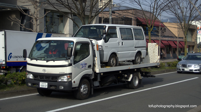 Van on a tow-away truck in Kyoto, Japan in March 2015