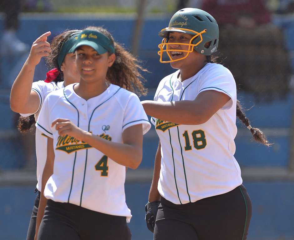 . 0517_SPT_TDB-L-MC-TORRANCE--- Torrance, CA--5/16/13--- Staff Photo: Robert Casillas  - Daily Breeze / LANG--- Mira Costa defeated Torrance High 7-1 in CIF DIV III softball playoff game at Wilson Park in Torrance. Fa Leilua (18) celebrates her homer.