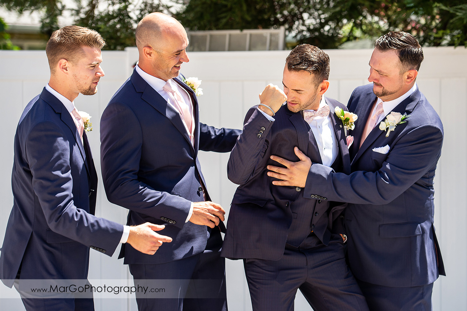 portrait of groom and groomsmen having fun in Walnut Creek