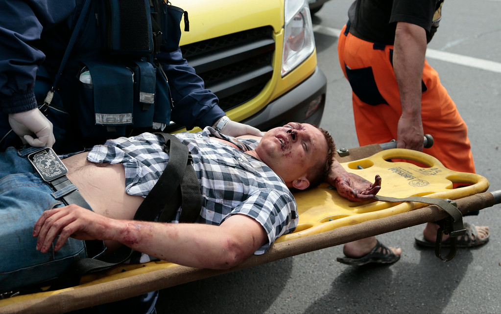 . Paramedics carry an injured man out from a subway station after a rush-hour subway train derailment in Moscow, Russia, on Tuesday, July 15, 2014.  (AP Photo/Ivan Sekretarev)