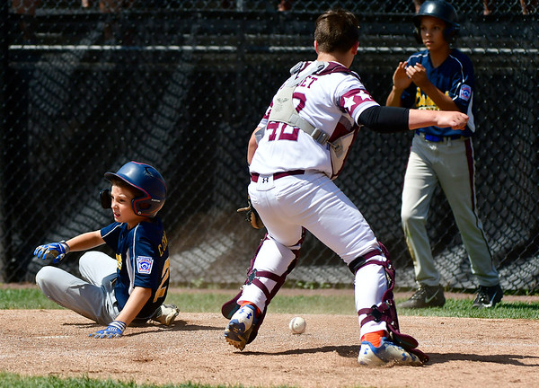 8/10/2019 Mike Orazzi | Staff Rhode Islands Barrington Little League's Cullen Crain (22) scores as New Hampshires Goffstown Junior Baseball Little League's Dillon Gaudet (42) reaches for the ball at Breen Field in Bristol, Conn., during the New England Regional Baseball Tournament.