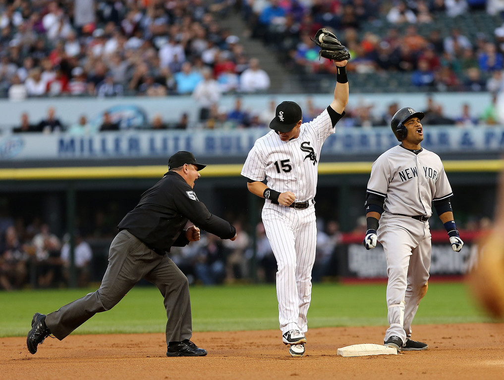 . Second base umpire Greg Gibson makes out call after the New York Yankees\' Robinson Cano gets tagged out at second by the Chicago White Sox\' Gordon Beckham in the first inning in a baseball game at US Cellular Field in Chicago on Monday, Aug.,5, 2013. (AP Photo/Charles Cherney)