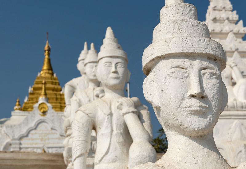 Sitting nat statues at Settawya Paya, Mingun, Burma (Myanmar)