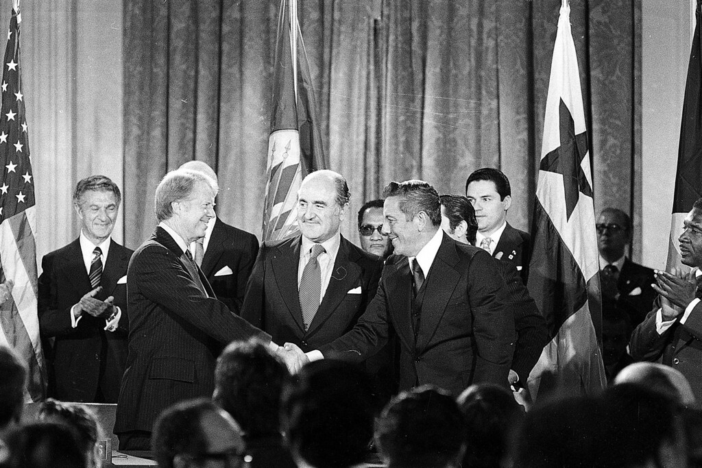. President Jimmy Carter shakes hands with Panama\'s head of government Omar Torrijos in Washington Sept. 7, 1977 after they signed the Panama Canal treaty.  Secretary General Alejandro Orfila stands at center.  (AP Photo)