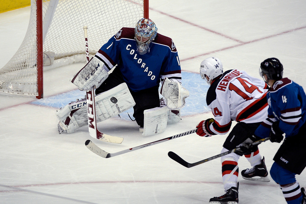 . Colorado Avalanche goalie Semyon Varlamov (1) makes a save on a shot by New Jersey Devils center Adam Henrique (14) during the second period January 16, 2014 at Pepsi Center. (Photo by John Leyba/The Denver Post)