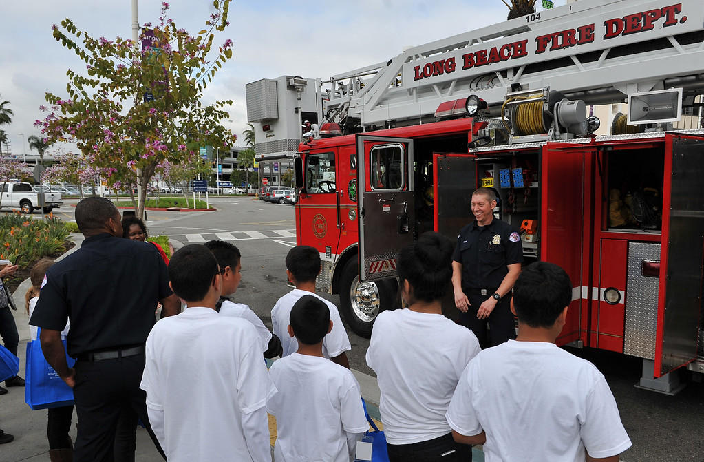 . 4/5/13 - Long Beach Memorial and Miller Children�s Hospital Long Beach are hosted its 15th annual �Bring Your Child to Work Day.� More than 160 children of employees came to work with their parents to learn about the medical profession and benefits of helping others. Members of the Long Beach Fire Department were on hand to show the kids the truck and the tools they use to save lives. Photo by Brittany Murray / Staff Photographer
