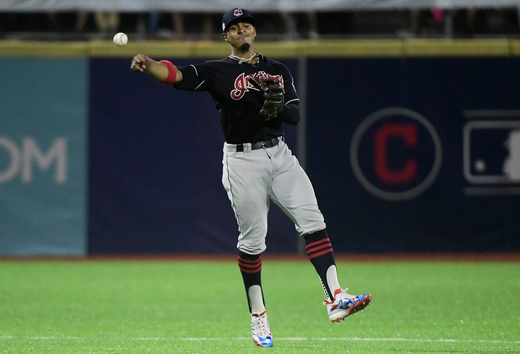 . Cleveland Indians\' infielder Francisco Lindor throws to first base in the seventh inning during the final match of a two-game Mayor League Series against the Minnesota Twins at the Hiram Bithorn Stadium in San Juan, Puerto Rico, Wednesday, April 18, 2018. (AP Photo/Carlos Giusti)