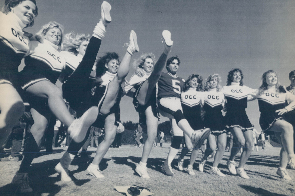 ". JAN 21 1987 - Anaheim, CA. Jan 20. New York kicker Sean Landeta practices his high steps with members of the Orange Coast College Cheerleading squad at a media ""Picture Day\"" at Orange Coast College. (Karl Gehring/The Denver Post)"