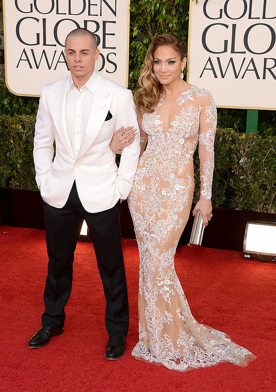 . Singer-actress Jennifer Lopez (R) and Casper Smart arrive at the 70th Annual Golden Globe Awards held at The Beverly Hilton Hotel on January 13, 2013 in Beverly Hills, California.  (Photo by Jason Merritt/Getty Images)