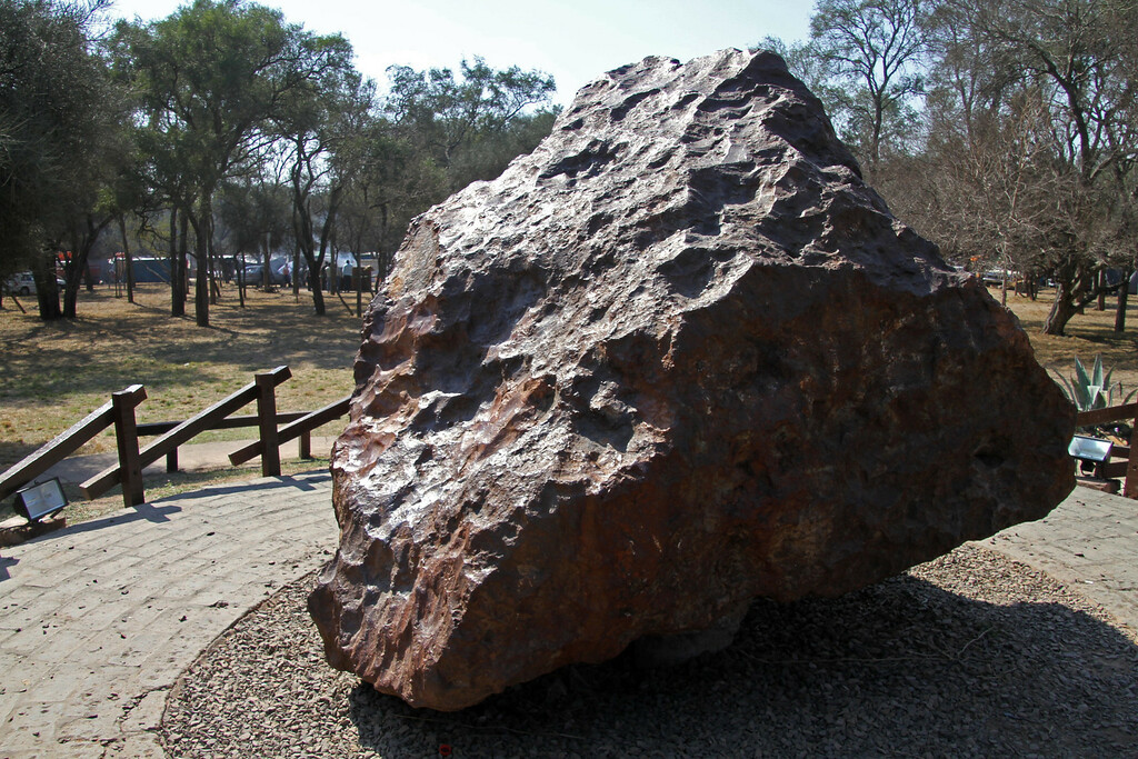 ". File photo taken in August, 2011 of ""El Chaco\"" meteorite in Gancedo, Chaco province, Argentina, 1100 km north of Buenos Aires. The 37 ton meteorite fell some 4,000 years ago and was unearthed on July 8, 1980 in an area called Piguen Nonralta (\""Field of Heaven\"" in Guaycuru indigenous language). Argentinian artist Nicolas Goldberg and French-born artist Guillermo Faivovich have the project to take \""El Chaco\"" to be exhibited in Documenta 13, a contemporary art fair in Kassel, Germany on September 2012. GEDEON PICASO/AFP/Getty Images"