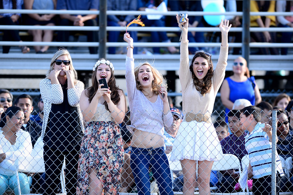 . Kim Rodriguez and her daughters Taylor, 15, Brooke Lynn, 22, and Madison, 23, cheer on Kim\'s son and their brother Frank Rodriguez as he receives his diploma during Wilson High School\'s forty-seventh commencement ceremony Tuesday evening, May 20, 2014 at the Hacienda Heights school. After high school the family is hoping Rodriguez joins the Navy. (Photo by Sarah Reingewirtz/Pasadena Star-News)