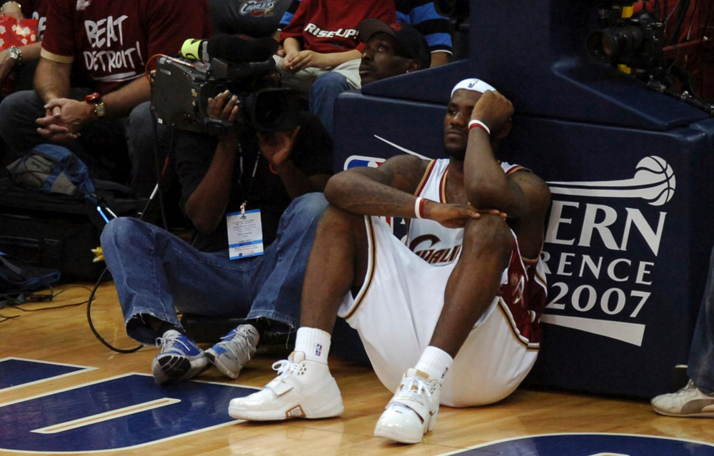 . MORNING JOURNAL/DAVID RICHARD LeBron James patiently waits during a delay in last night\'s game caused by a malfunctioning shot clock.