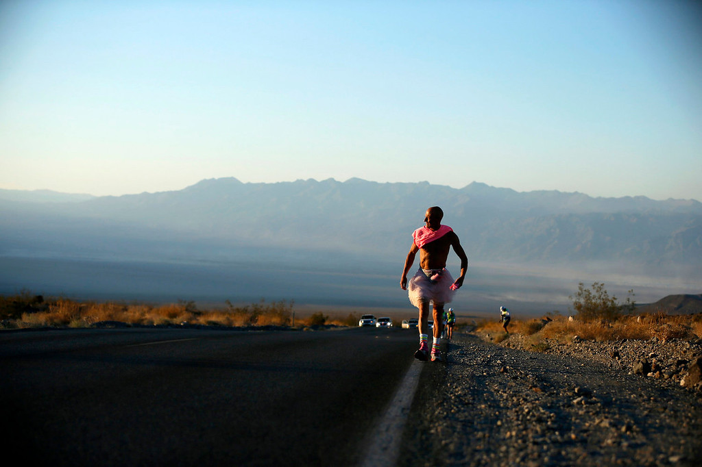 . Keith Straw, 58, competes during the Badwater Ultramarathon dressed in a tutu in Death Valley National Park, California July 15, 2013. The 135-mile (217 km) race, which bills itself as the world\'s toughest foot race, goes from Death Valley to Mt. Whitney, California in temperatures which can reach 130 degrees Fahrenheit (55 Celsius).  REUTERS/Lucy Nicholson