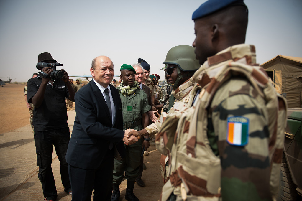 . French Defence Minister Jean-Yves Le Drian shakes hands with African soldiers of Serval Operation, on April 26, 2013 in French Army base of Gao. MARTIN BUREAU/AFP/Getty Images