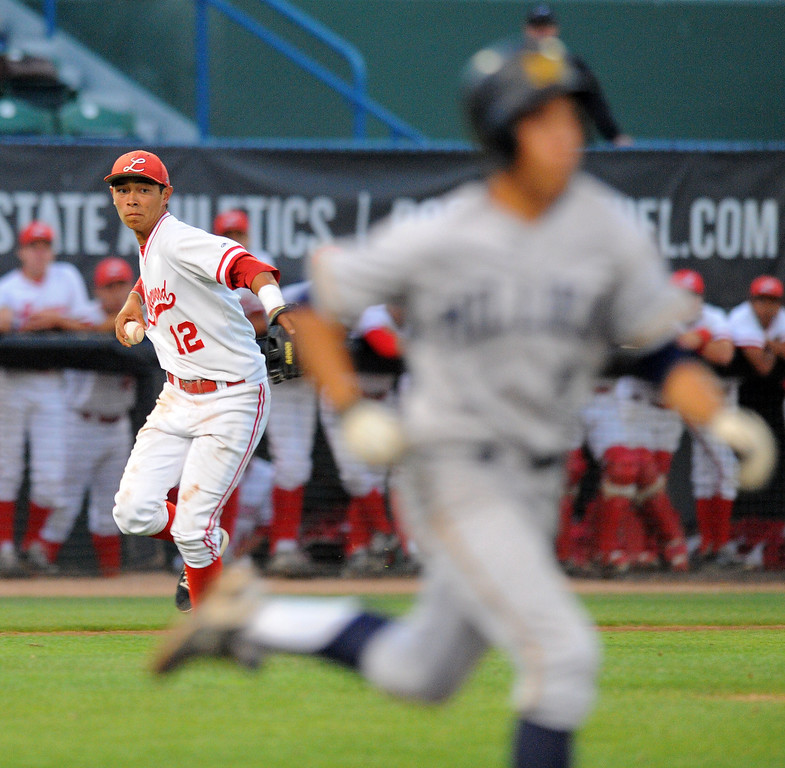 . LONG BEACH - 05/01/13 - (Photo: Scott Varley, Los Angeles Newspaper Group)  Lakewood vs Millikan baseball at Blair Field. Millikan\'s Jacob Hughey beats the throw to first from Kyle Clary.