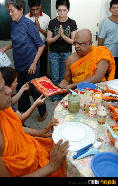 Before the monk started their lunch, new cloth has been offered to the monk.