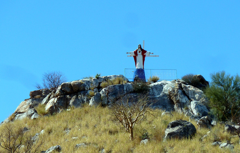 Jesus on top of a hill. This could be any hill in Mexico.