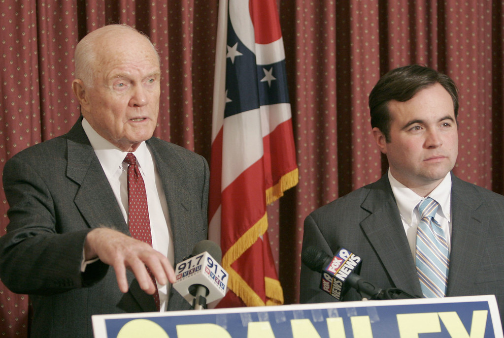 . Former senator and astronaut John Glenn, left, speaks with Democratic congressional candidate John Cranley during a news conference after a campaign event for Cranley, Thursday, Oct. 26, 2006, in Cincinnati. Cranley is running against incumbent Steve Chabot, R-Ohio. (AP Photo/David Kohl)