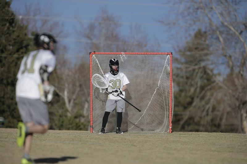 JPM0163-JPM0163-Jonathan first HS lacrosse game March 9th.jpg