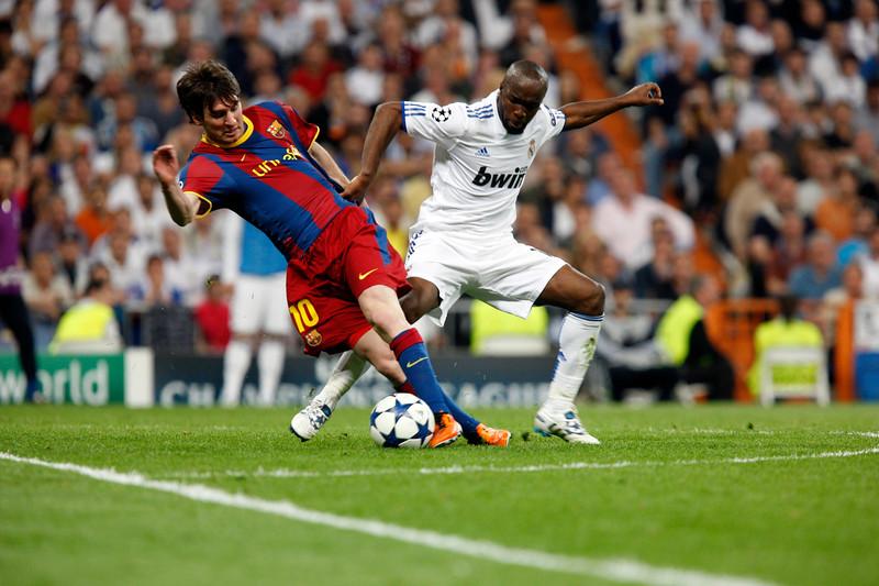 Messi trying to dribble past Lassana Diarra, UEFA Champions League Semifinals game between Real Madrid and FC Barcelona, Bernabeu Stadiumn, Madrid, Spain