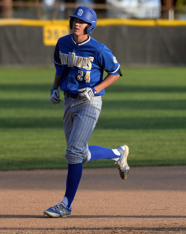 . San Dimas\' Peter Lambert (C) rounds third base after hitting a two run home run in the first inning of a prep baseball game against Bonita at Bonita High School in La Verne, Calif., on Wednesday, March 19, 2014.  (Keith Birmingham Pasadena Star-News)