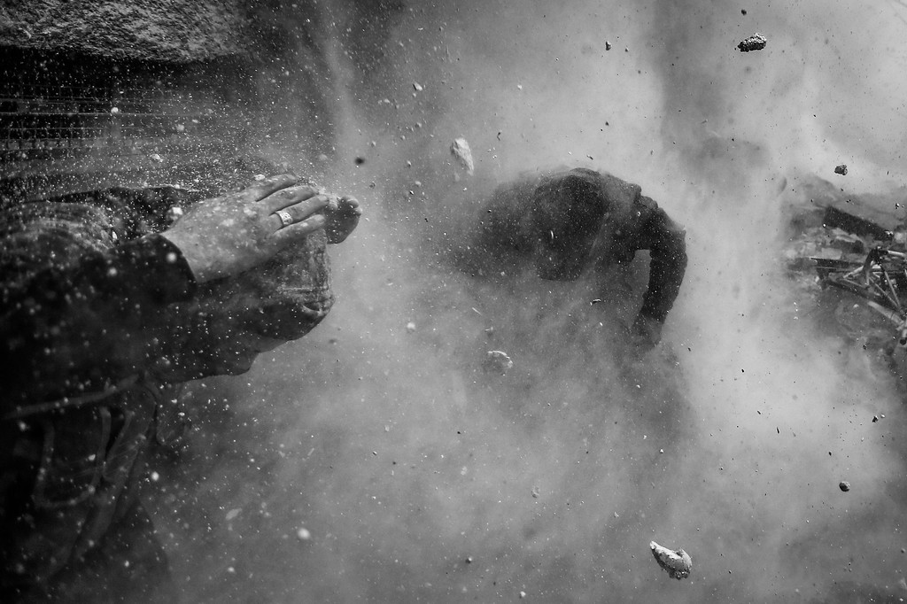. This picture by Serbian photographer Goran Tomasevic, Reuters, won 1st Prize in Spot News Stories category of the 57th World Press Photo Contest, it was announced by the organizers in Amsterdam, The Netherlands, 14 February 2014. It shows Syrian rebel fighters taking cover as a tank shell explodes on a wall after their comrade was shot by sniper fire during heavy fighting in the Ain Tarma neighbourhood of Damascus, Syria.  EPA/GORAN TOMASEVIC / REUTERS
