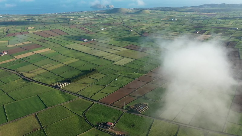 Available in 4K - Aerial video clip on the typical abstract countryside of the east of Terceira Island, one of the islands of the Açores (Azores) archipelago. Serra da Ribeirinha and The Miradouro da Serra do Cume offer great views on these abstract dairy cattle farming fields with stone walls