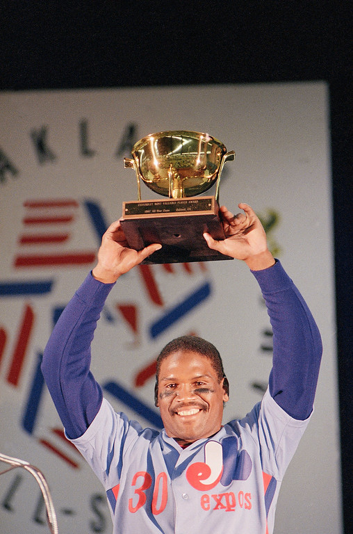 . TIM RAINES -- National League All-Star Tim Raines of the Montreal Expos hoists his Most Valuable Player trophy after the All-Star game on July 15, 1987, in Oakland. Raines collected three hits and drove in the tie-breaking runs with his 13th-inning triple to lead the National League to a 2-0 victory. (AP Photo/Paul Sakuma)