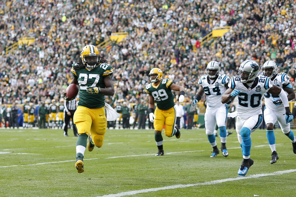 . Eddie Lacy #27 of the Green Bay Packers rushes on a five-yard touchdown run in the first quarter of the game against the Carolina Panthers at Lambeau Field on October 19, 2014 in Green Bay, Wisconsin. (Photo by Joe Robbins/Getty Images)