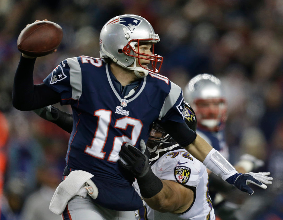 . New England Patriots quarterback Tom Brady is pressured by Baltimore Ravens defensive end Haloti Ngata (92) during the first half of the NFL football AFC Championship football game in Foxborough, Mass., Sunday, Jan. 20, 2013. (AP Photo/Steven Senne)